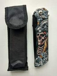Folding Knife With Wolf Skull Ornament