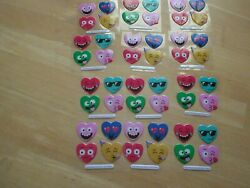 12 Sheets Of 4 Stickers In 8 Different Glittery Colored Faces .