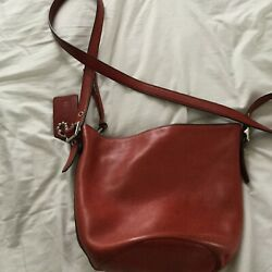 Coach women's red leather cross body bag $32.00