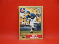 2001 Topps Traded Greg Maddux #T123 1987 #T70 Rookie Reprint
