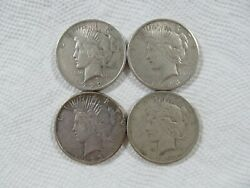 Lot Of 4 1922-1925 Silver Peace Dollars In A F-xf Condition. Lot 7