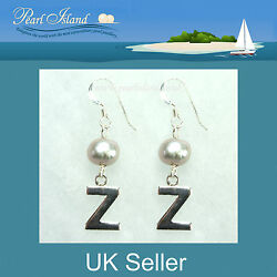 Personalised Freshwater Pearl Earrings With One Silver Grey Baroque Pearl