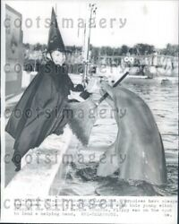 1959 Cute Porpoise Tries To Borrow Broom From Girl Dressed As Witch Press Photo