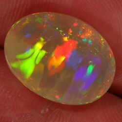 8.5ct Angel Inside This Ethiopian Welo Opal. Fire Crystal Cabochon Wello Wollo