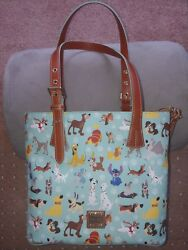 NWT.  Dooney and Bourke Disney dogs tote PERFECT placement.