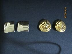 Lot of 2 Pair of Clip on Earrings..One Gold Tone and One Silver Tone.