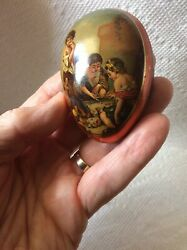 Antique Tin Flat Easter Candy Container Egg -boys Gambling Playing Dice W/ Dog