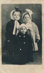 C1910 3 Little Darlings All Bundled Up Coats, Winter Hats And Ribbons Children