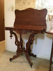 Antique Victorian Parlor Game Table Rotating Flip Top Walnut Carved Accents