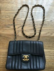 CHANEL Black Vertical Quilted Lambskin Leather Mini Rectangular Flap Bag