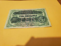1933 East Africa Rare Ten Shilling Nice Vf With A Worm Hole In The Brown Center