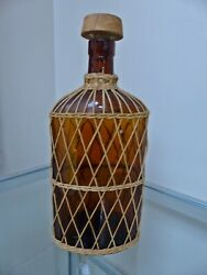 Antique Hawaiian/tropical Style Wicker Mash Wrapped Flask Amber Glass Bottle