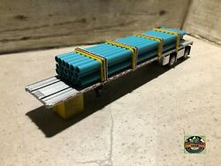 Custom Dcp Spread Axle Flatbed Trailer With Teal Blue Stain Pipe Loads 1/64