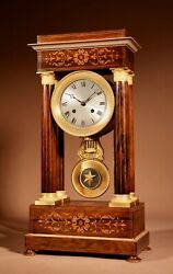 Charles X Rosewood/palisandre Inlaid With Lemon Wood And Ormolu Portico Clock