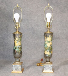 Pair Of Fornasetti Style Silver Leaf Reverse Painted Andeacuteglomisandeacute Lamps With Bronze