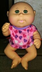 Cabbage Patch Kid Baby Doll Wearing A Pink Heart Shirt