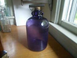 1909 Amethyst Purple Glass One Gallon Whiskey Jug With Handle And Cork Stopper