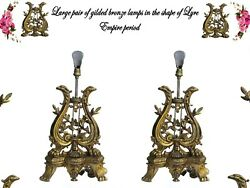 Pair Of Gilded Bronze Lamps In The Shape Of A Lyre Surmounted By Two Eagle