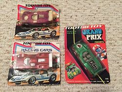 3 tootsietoy race cars in unpunched