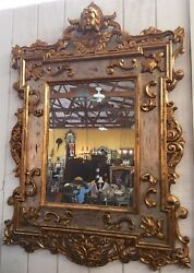 Hanging Figural Wall Mirror | Gilded Hand-carved Frame