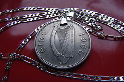 Lucky 1966 Antique Irish Harp And Fish Coin Pendant On A Silver Link Chain.