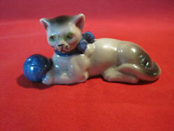 Vintage porcelain cat figurine playing with a ball marked Japan