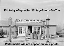 Old 1939 Texas Truckers Visible Gas Pumps Station Cooper Tires Motor Oil Photo