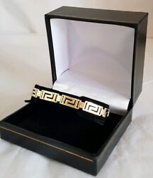 A Modern 14ct Yellow Gold Bracelet. The Links Fashioned In The Greek Key Design