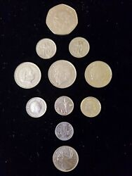 Lot Of 11 Foriegn Coins Isreal Dutch Pesos Malaysian And Canadan 1969-2007
