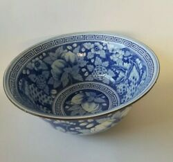 Blue and white bowl with fruit and floral pattern with brass trim