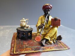 Cold Painted Bronze Seated Arab On Rug Smoking With Book And Coffee Table