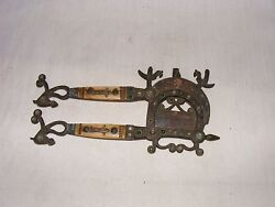 A Scare Antique Brass Nut Cutter With Glass And Bone Inlay Horse Fish Bird