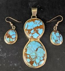 14k And High Grade Bisbee Turquoise Pendant And Earrings Signed With A Rams Head