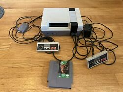 Nintendo Entertainment System Console With Tacmo Bowl.