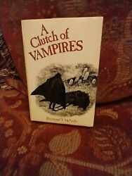 A CLUTCH OF VAMPIRES BY RAYMOND T. MCNALLY VERY GOOD COND. $38.00