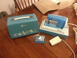 1960s Childs Sister Sewing Machine Mdl 25 Powers Up, Lights, Pedal Needs Repair.