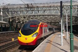 Photo Glasgow Central Station - 8 April 2014 2 With Virgin Trains 390 009 Awa