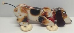 Vintage 1961 Fisher Price Snoopy Pull Dog Toy [listing 2]