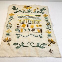 vintage handmade embroidered floral linen wall hanging quilt block yellow 70s