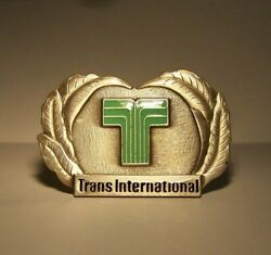 Late 1960and039s-1979 Trans International Airlines Pilot Hat Badge 3rd Issue