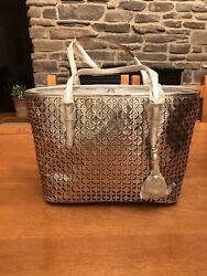 MICHAEL KORS FLOWER PERFORATED SMALL TRAVEL TOTE SILVER