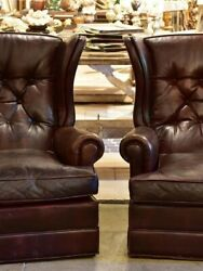 Pair of 1950's leather wing back armchairs