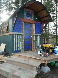 Gypsy Vardo Caravan tiny house on wheels whimsical colorful wired bed sink