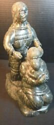 Northern Canadian Inuit Soapstone Sculpture Of Man Woman And Child