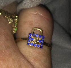 Ain't no broke bitch ring ! Louis Vuitton 18 kt Sapphire Lock Ring