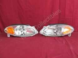NOS OEM Ford Escort ZX2 2-Door Coupe Headlamp Light Early 1998 Models PAIR