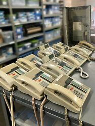 Meridian Norstar Telephone System With 11 Off-white Phones