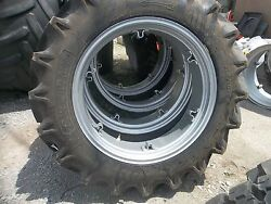 Two 11.2x28, 11.2-28 8ply R1 Tractor Tires W/ 6 Loop Wheels
