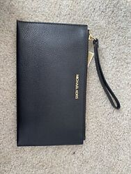 michael kors wristlet women brand new w tags. perfect condition. black and gold $46.99