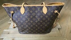 Pre Owned Louis Vuitton Neverfull Mm Brown Monogram Handbag With Yellow interior $1000.00